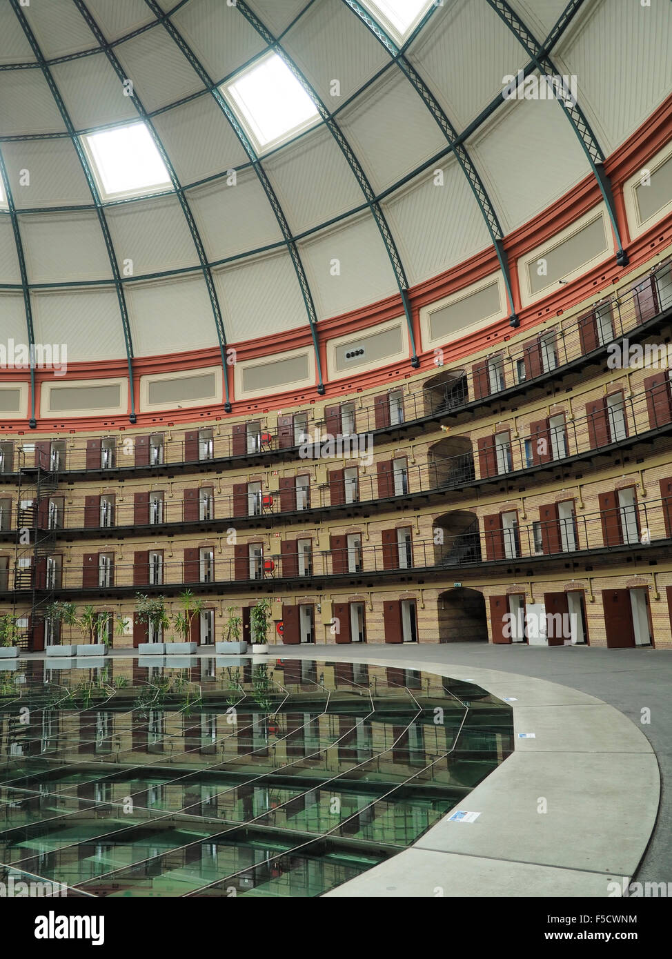 Interior of the round dome prison koepelgevangenis in Breda, the Netherlands, with open cell doors. The prison was - Stock Image