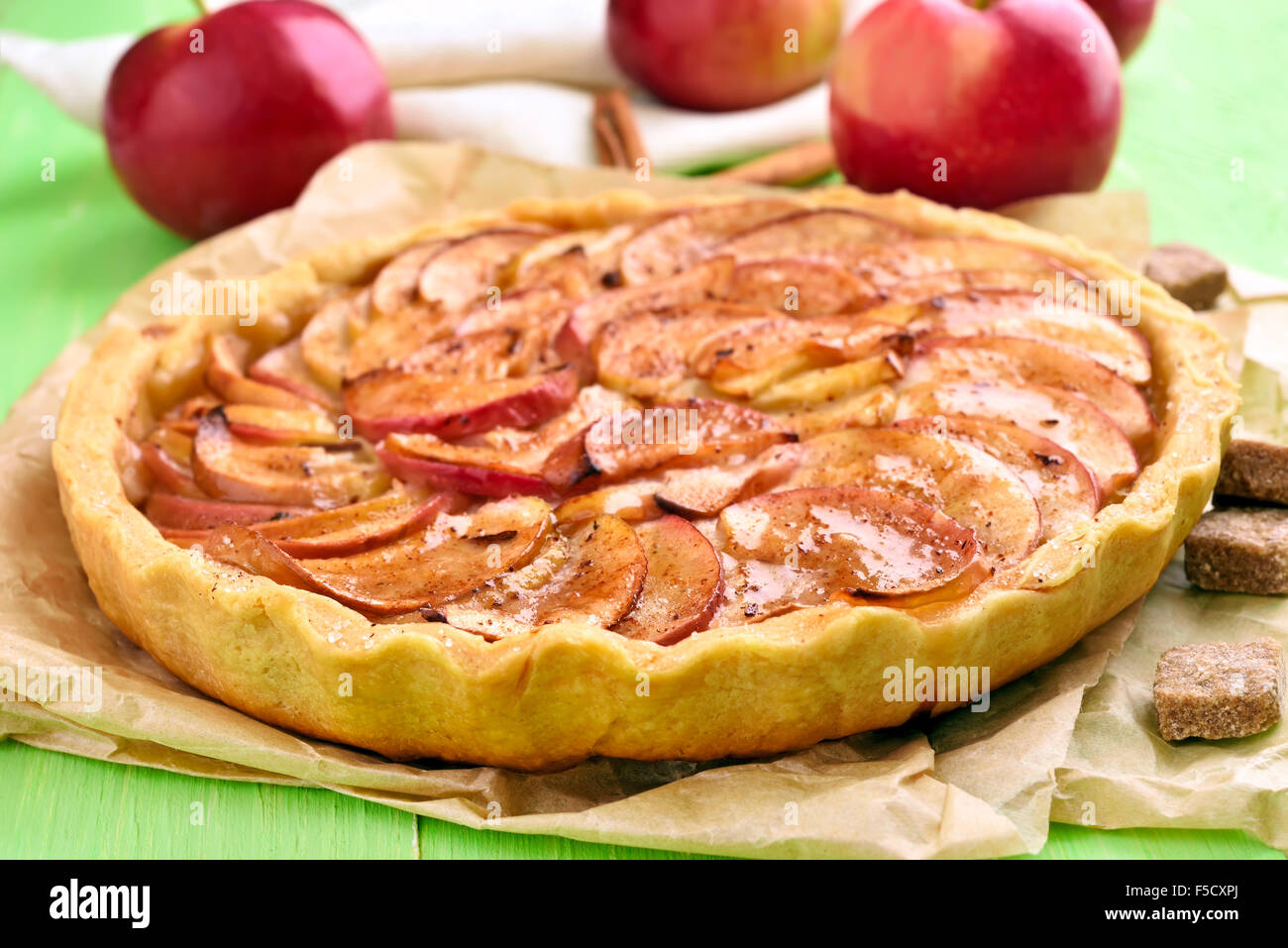 Apple pie on baking paper, close up view Stock Photo
