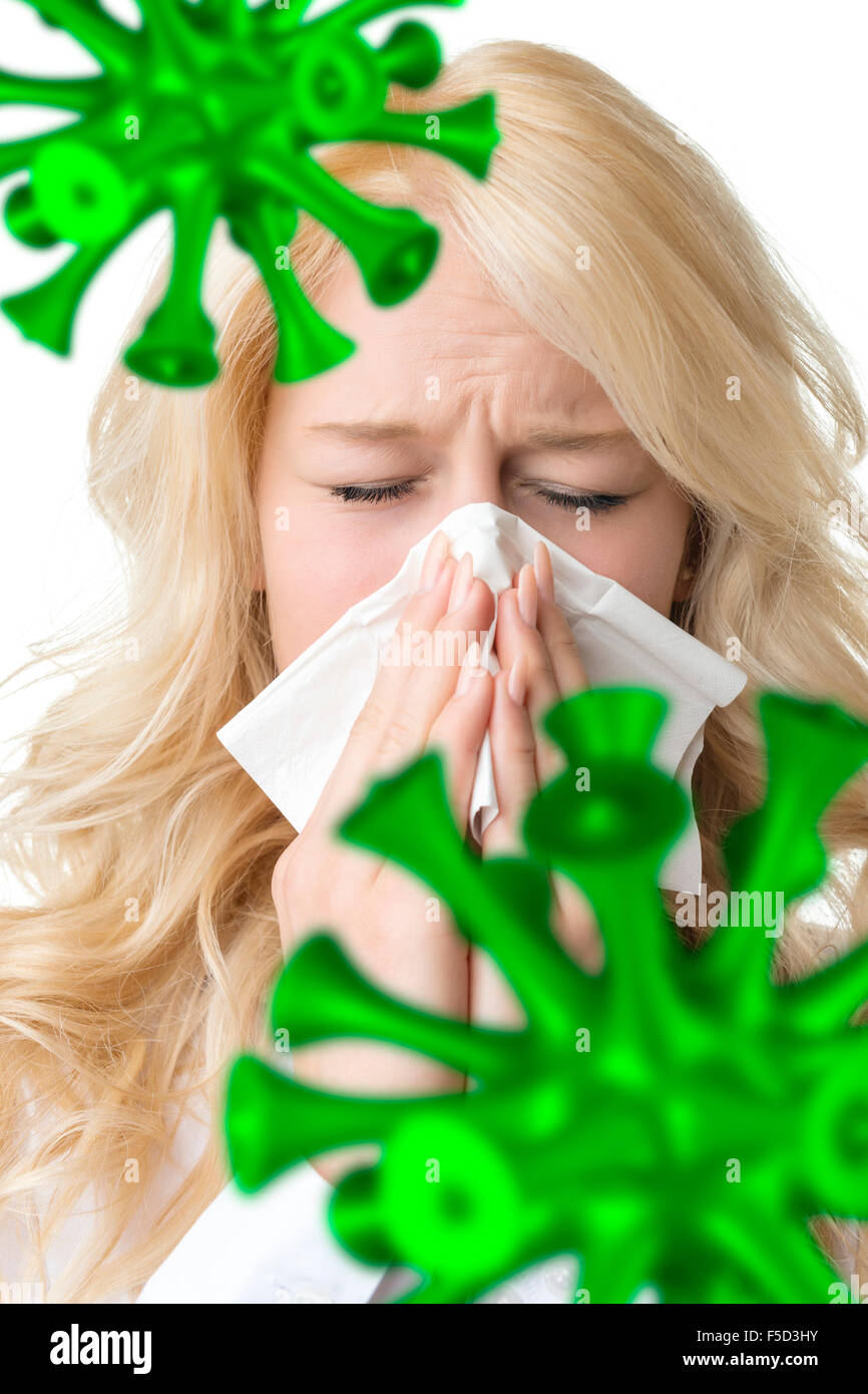 Portrait of a ill blond woman who is sneezing bacillus in a virus - Stock Image