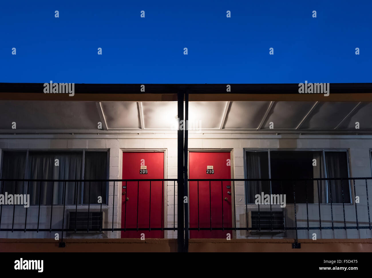 Cheap motel room doors. - Stock Image