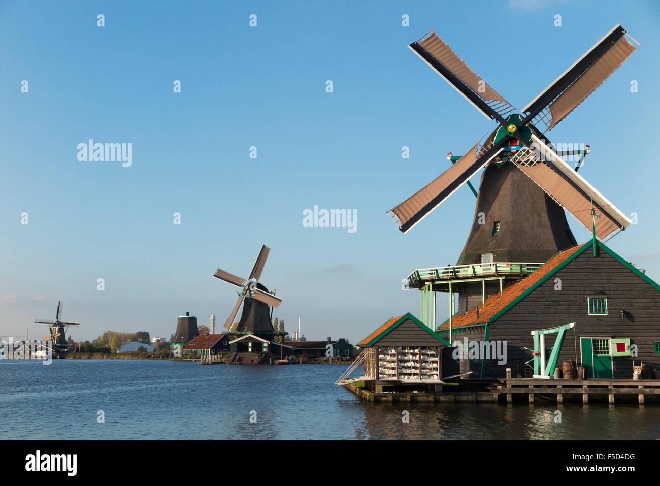 De Kat paint Dutch windmill (nearest to camera) / wind mills / windmills / wind mills, Zaanse Schans, Holland, The - Stock Image