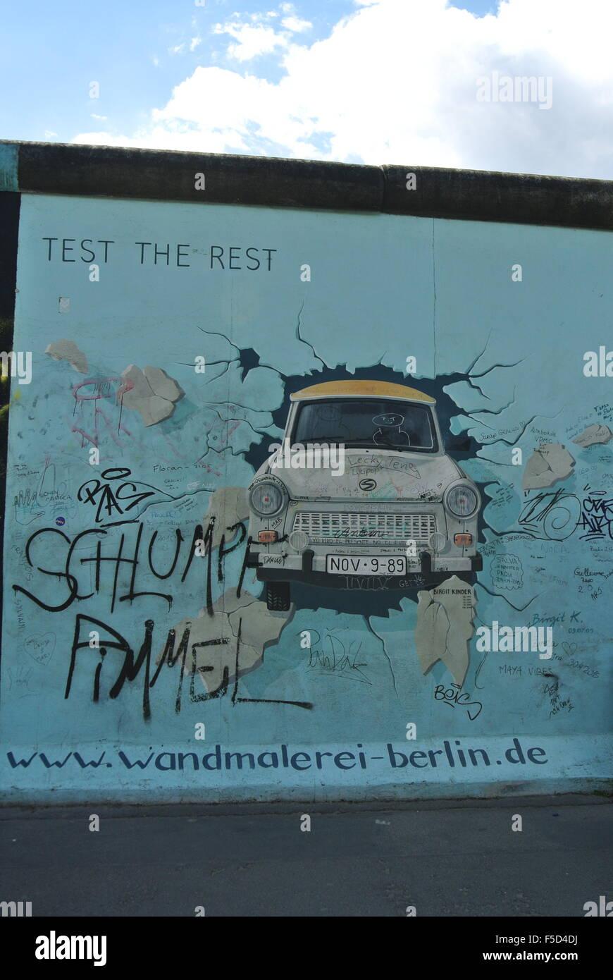 Graffiti, Car smashing through wall, Berlin Wall - Stock Image
