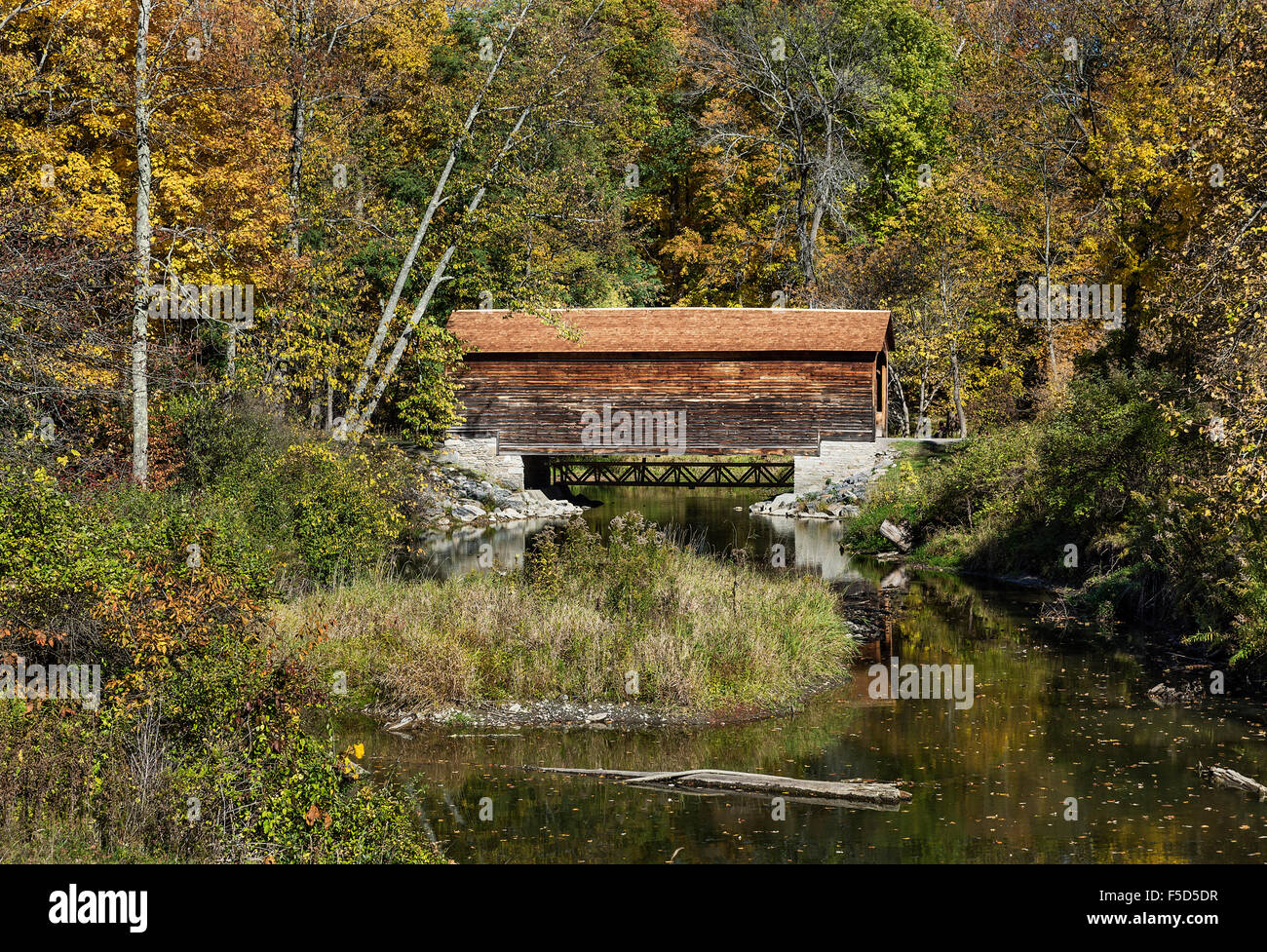 Hyde Hall covered bridge is the oldest existing covered bridge in the United States, Glimmerglass State Park, New - Stock Image