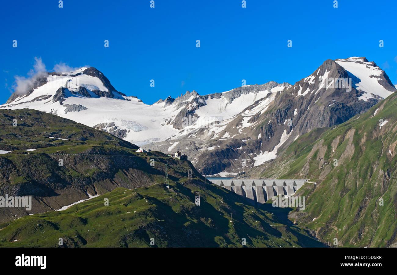 Lago del Sabbione damn, from left to right Ofenhorn peak, Punta d'Arbola and Punta del Sabbione, Pomattertal, - Stock Image