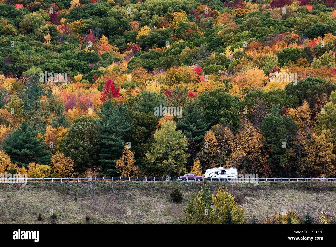 RV camper on an autumn road trip, Castleton, New York, USA - Stock Image