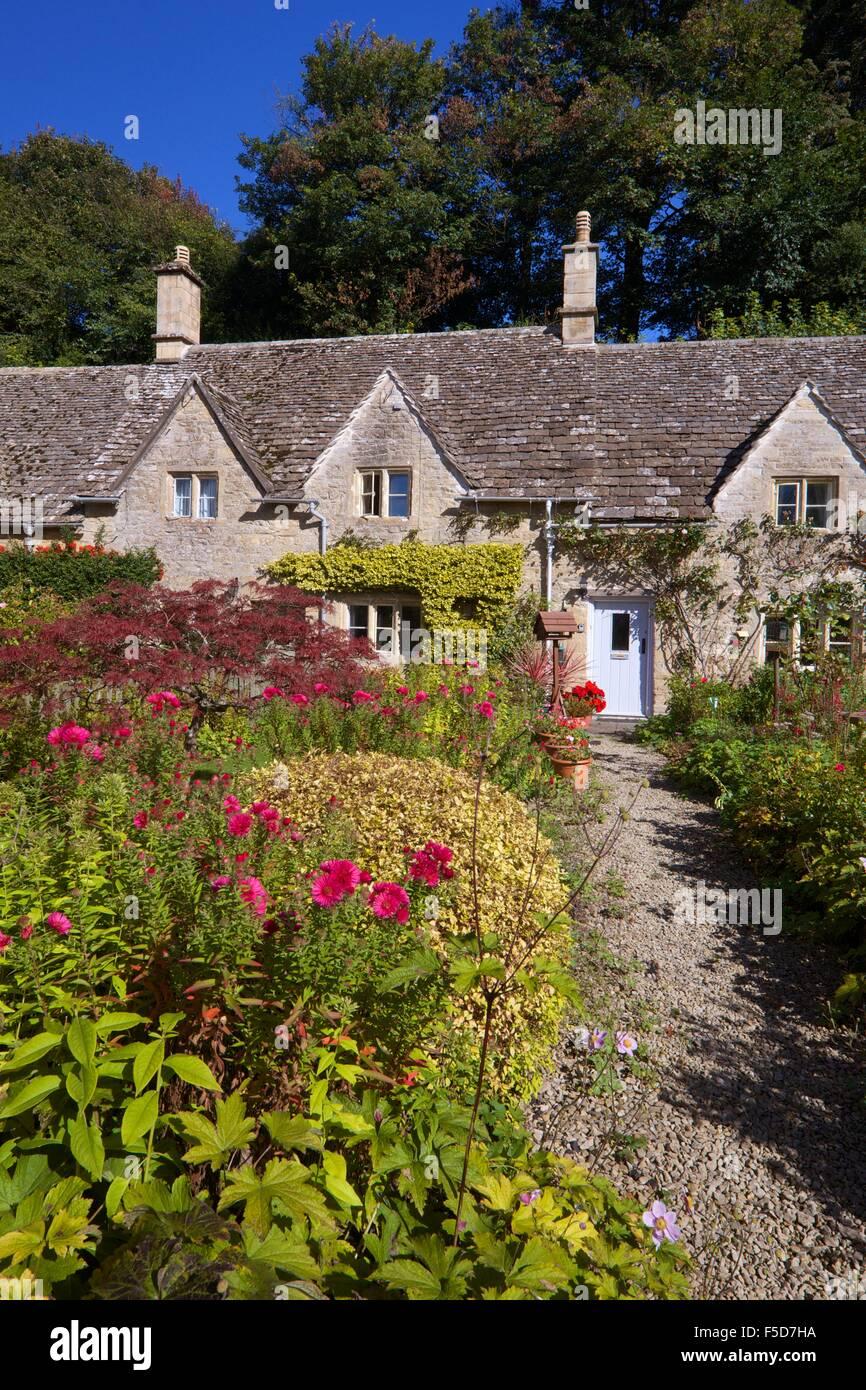 Traditional cottage garden,  Bibury, Cotswolds, Gloucestershire, England, UK, GB, Europe - Stock Image
