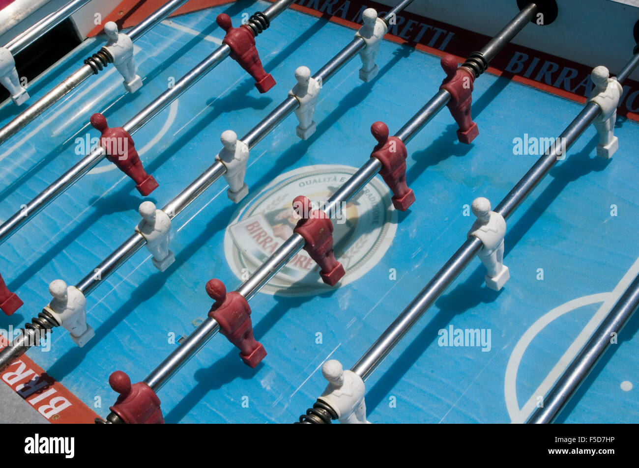 table football foosball ball tables Tischfußball play playing players bar game games foot foos balls - Stock Image
