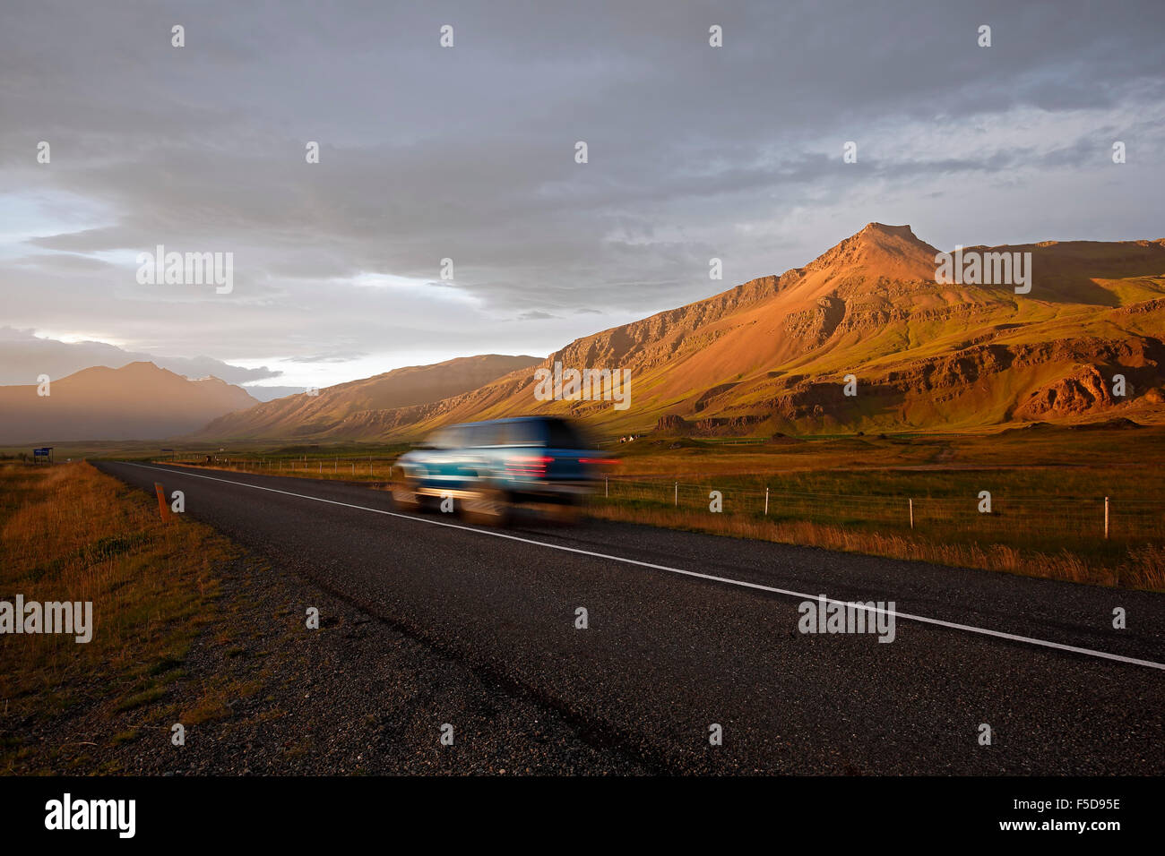 SUV on Route 1 (Ring Road) and mountain landscape near Hofn, Iceland Stock Photo