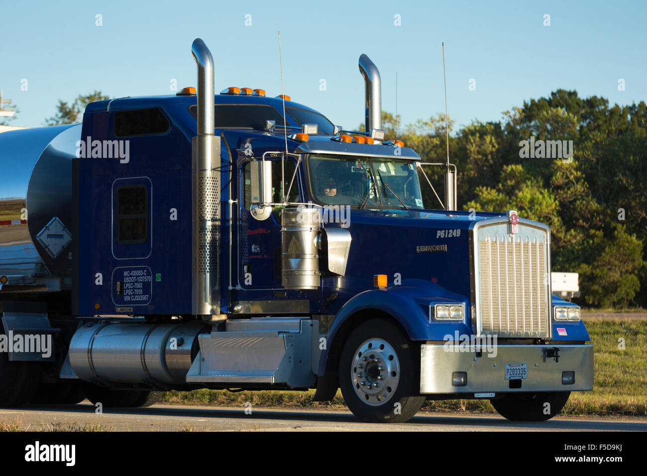 Typical clean, shiny American Kenworth truck bulk liquid freight transport on trucking route Interstate 10, Louisiana, - Stock Image