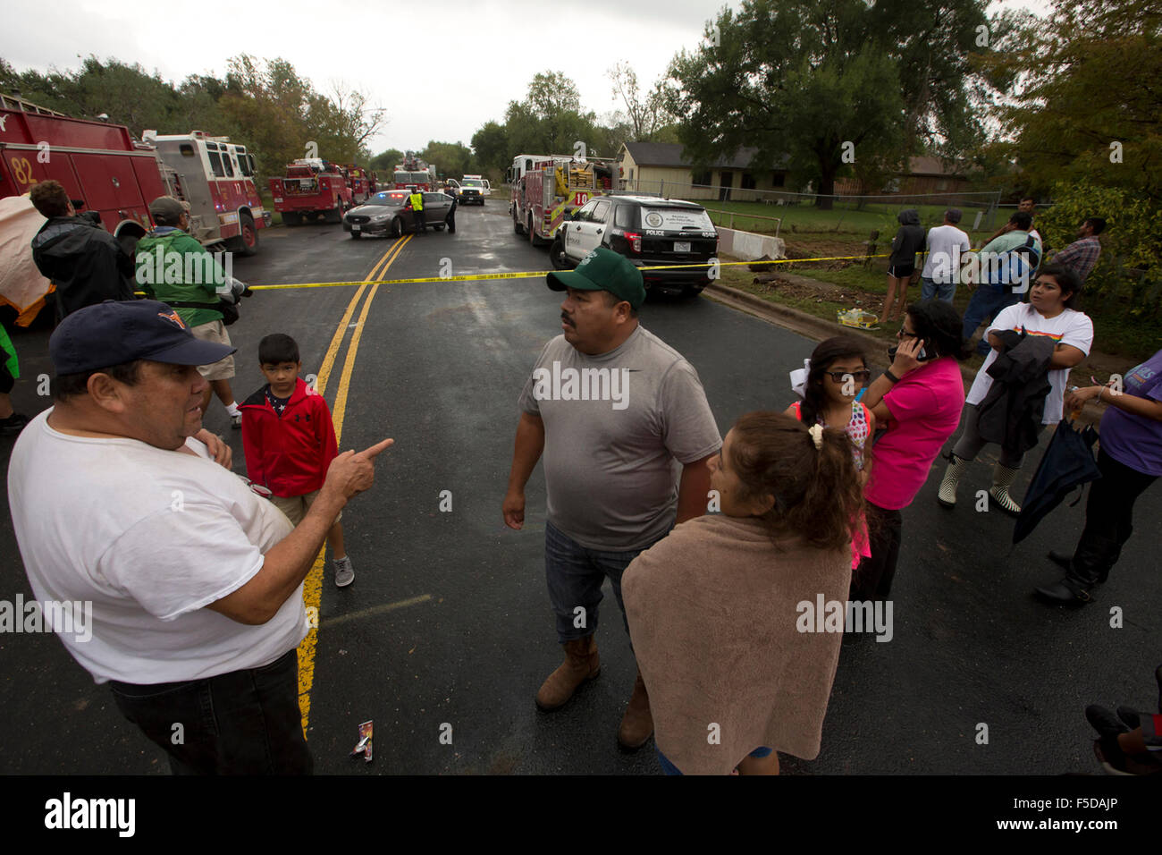 Residents of the Onion Creek neighborhood who were able, fled their homes on October 30, 2015 after flash flooding - Stock Image