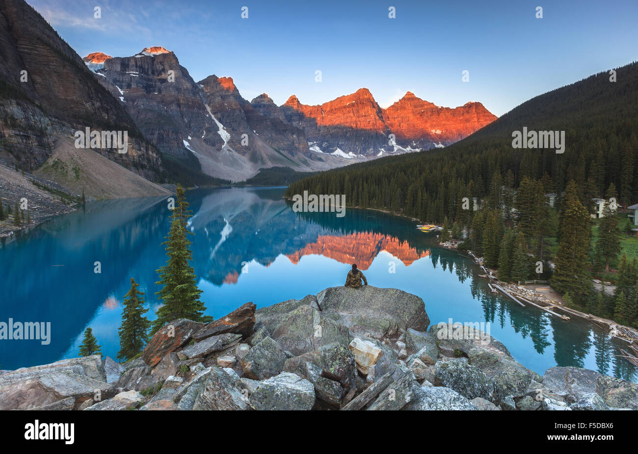 A man enjoying the view of Moraine Lake by sunrise, Banff National Park, Alberta, Canada, America (Canadian Rocky Stock Photo
