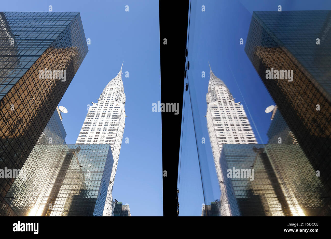 Manhattan skyscrapers reflected in windows at sunset, NYC, USA. - Stock Image