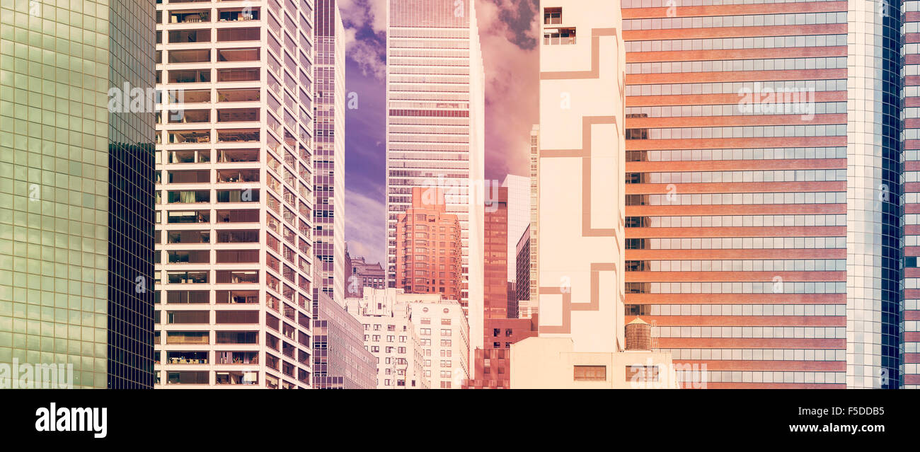 Retro stylized panoramic view of buildings in New York City, USA. - Stock Image
