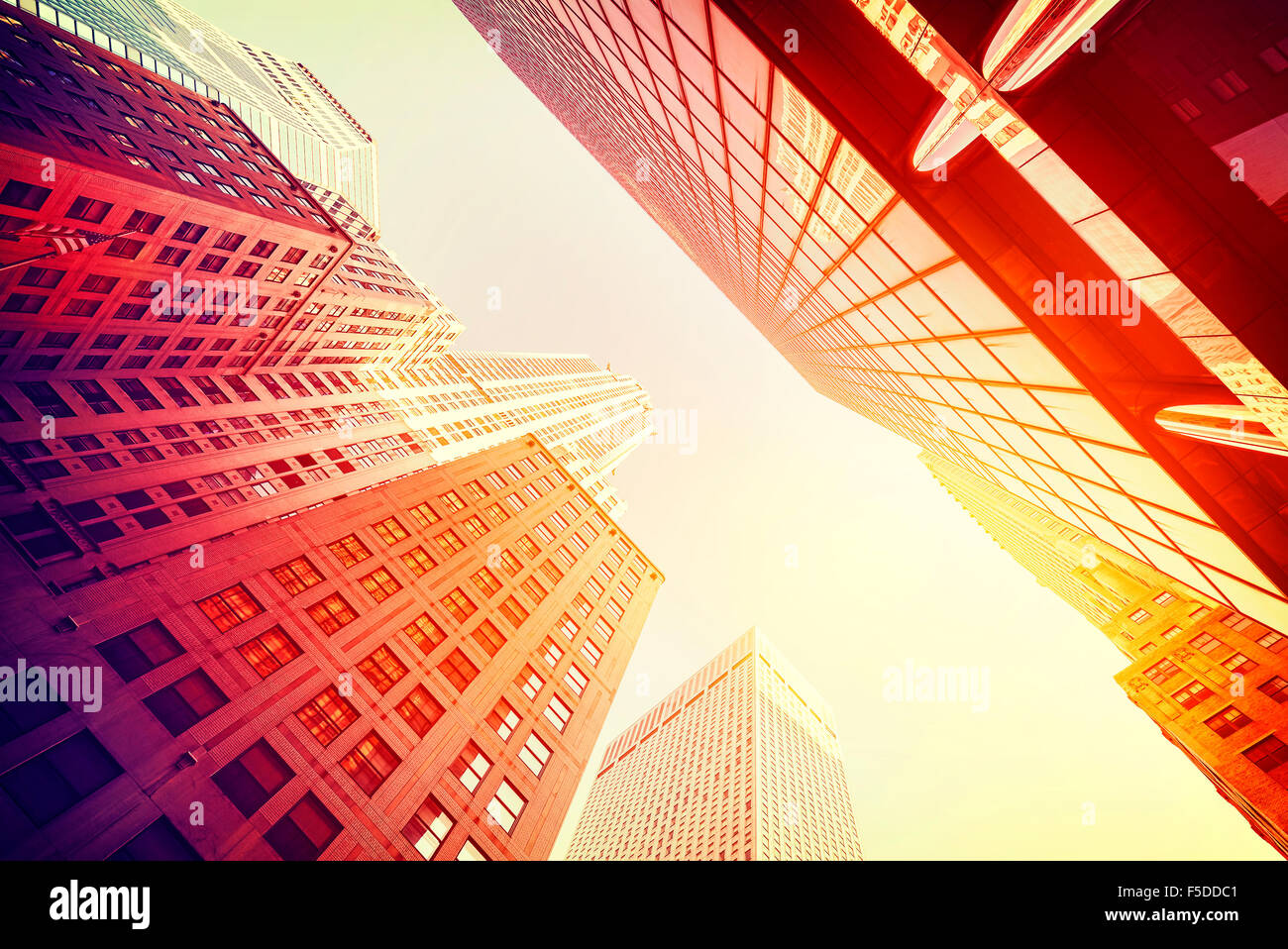 Vintage style skyscrapers in Manhattan at sunset, NYC, USA. - Stock Image