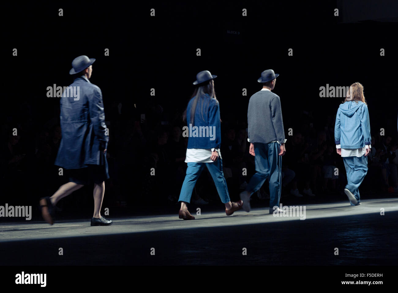 Male models walking towards the camera at London fashion week or LCM - Stock Image