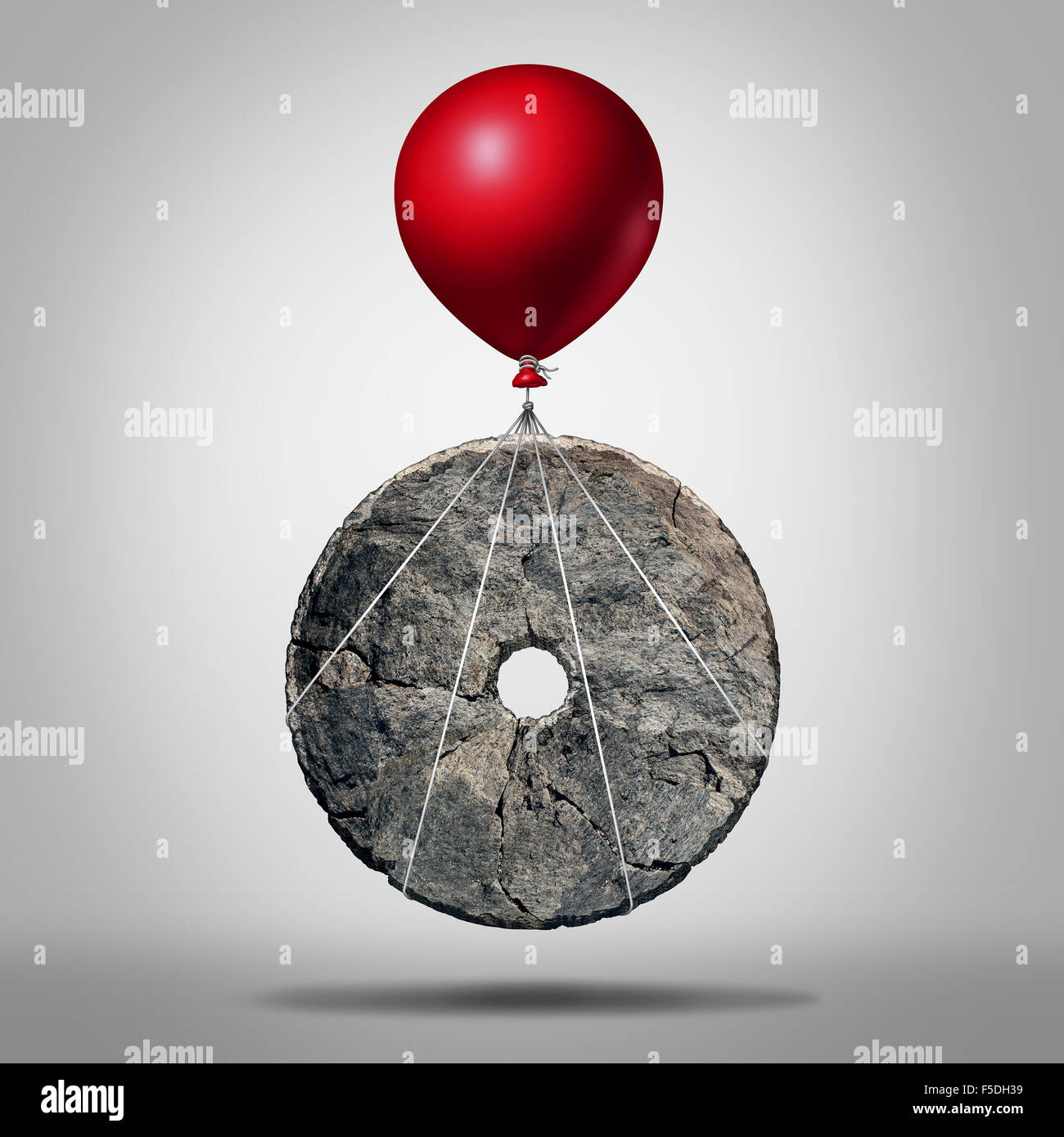 Technology progress and invention revolution,symbol as an early stone wheel being lifted by a balloon as a modernization - Stock Image