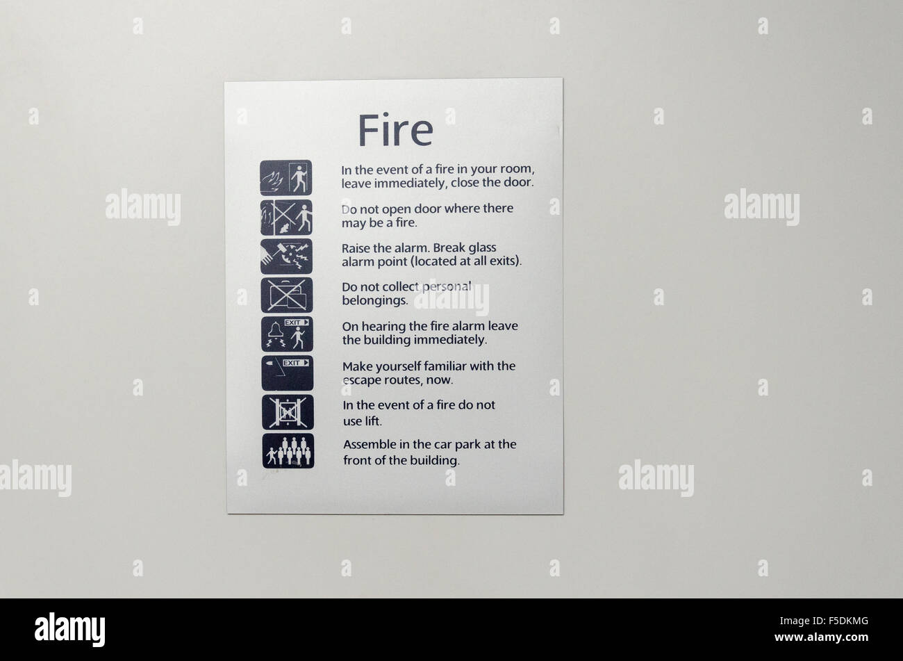 Fire safety and evacuation sign in a hotel - Stock Image