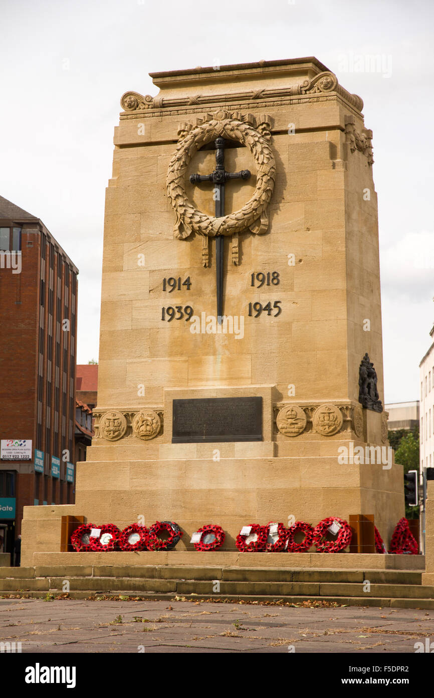 The Cenotaph in Bristol with poppy wreaths at the base. - Stock Image