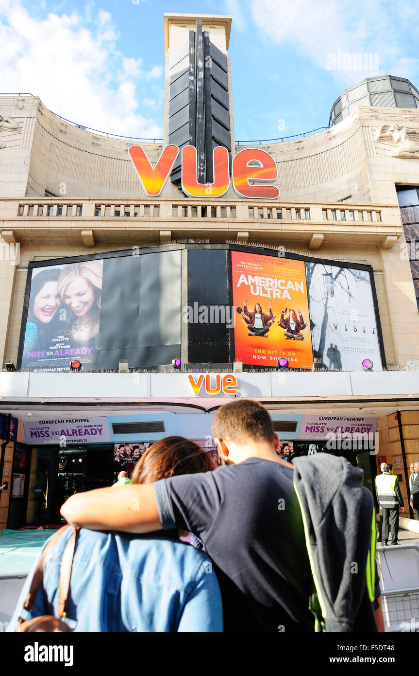 Couple outside Vue Cinema, Leicester Square, West End, City of Westminster, London, England, United Kingdom - Stock Image