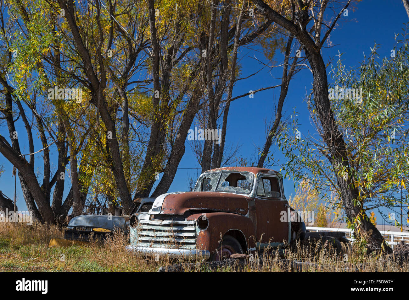Bountiful, Colorado - An old rusted pickup truck with windows smashed. - Stock Image