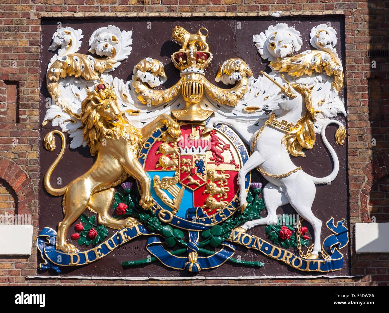 Royal Coat of Arms at entrance gate to Chatham Historic Dockyard, Chatham, Kent, England, United Kingdom - Stock Image