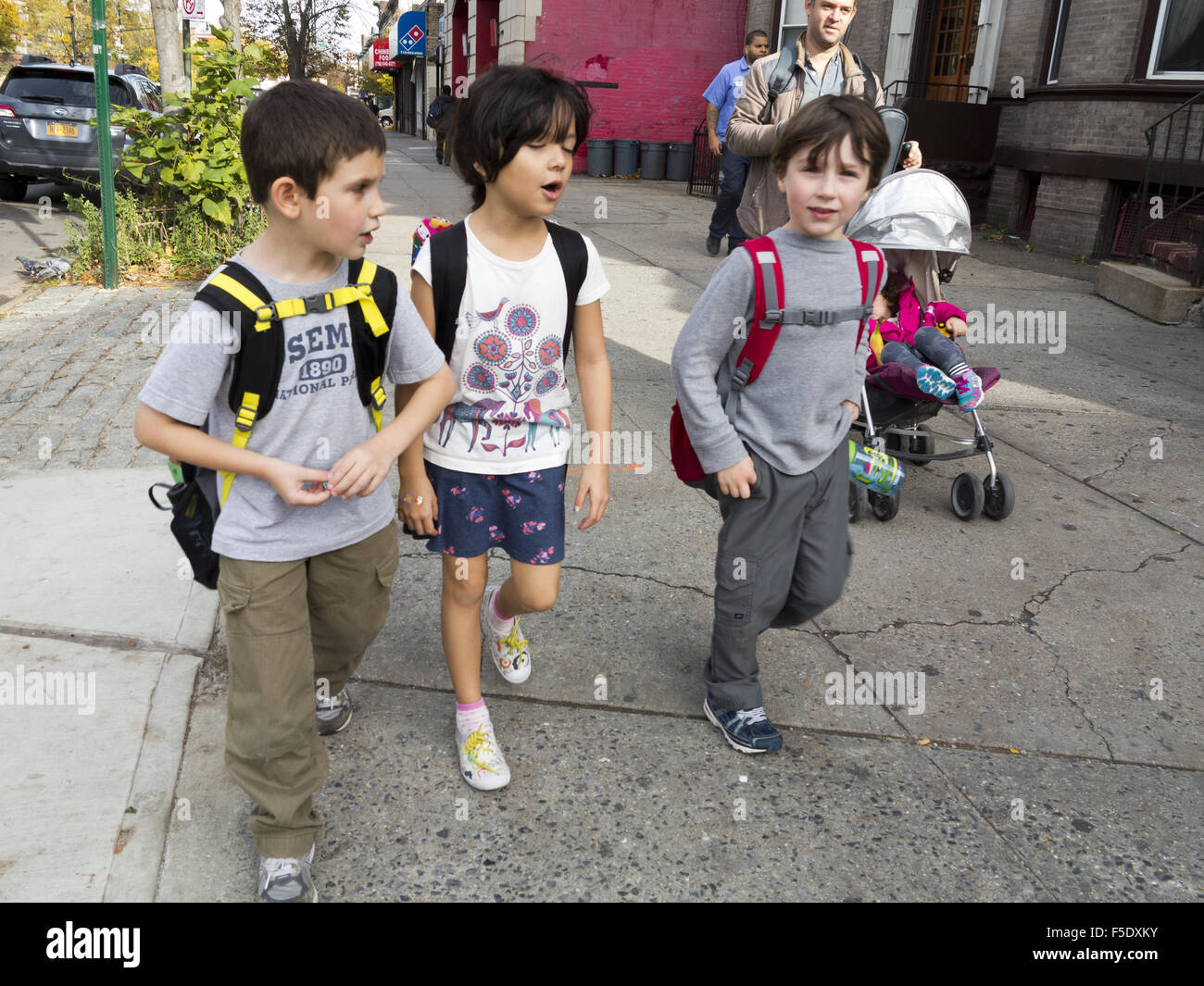 Children going home with their mother after school in Ditmas Park, Brooklyn, NY, 2015. - Stock Image