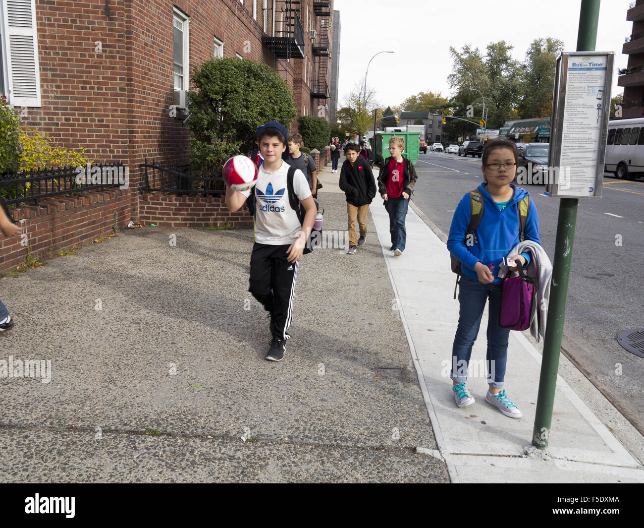 Children going home after school in Kensington, Brooklyn, NY, 2015. - Stock Image