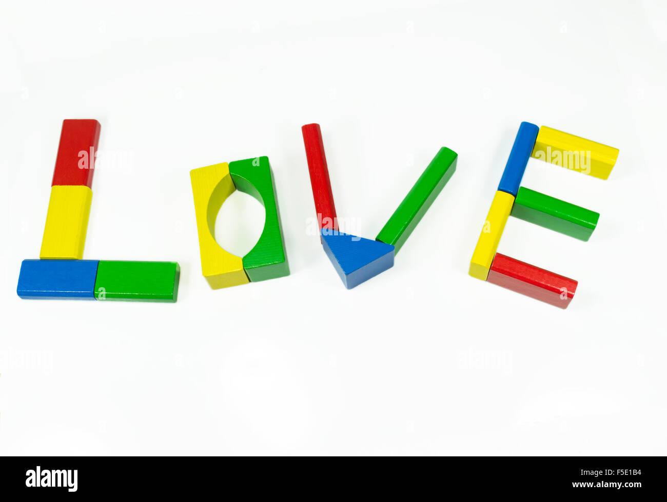 The word 'love' formed by arranging into letters colored wooden pieces, isolated on white - Stock Image