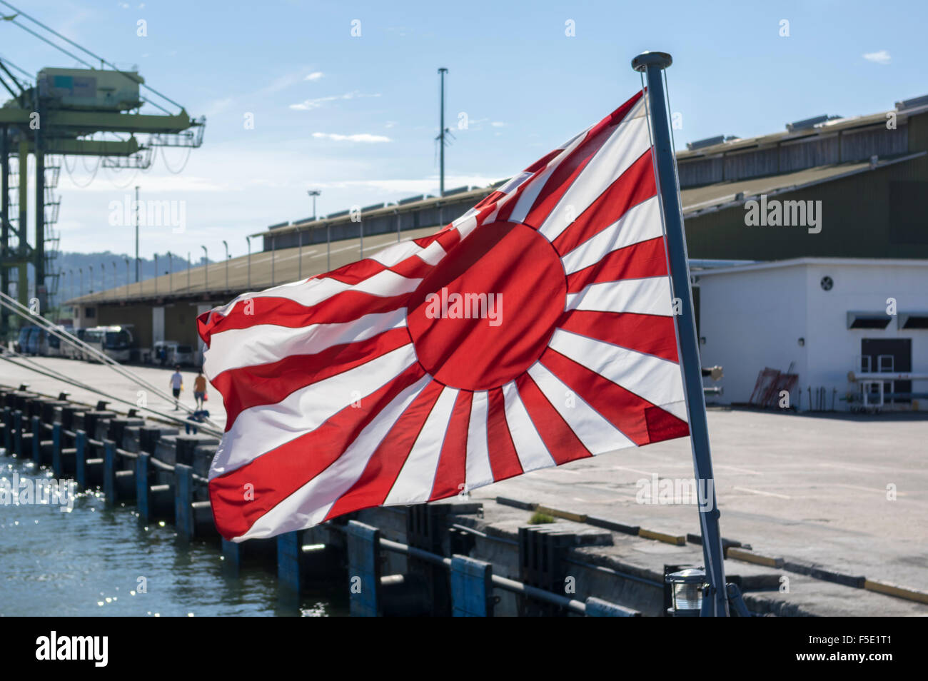 Japanese Naval Ensign, called the Rising Sun Flag, as flown since 1954. Its design is still very close to the one - Stock Image