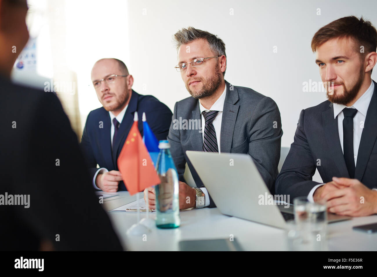 Group of business partners attending intercultural conference or seminar - Stock Image