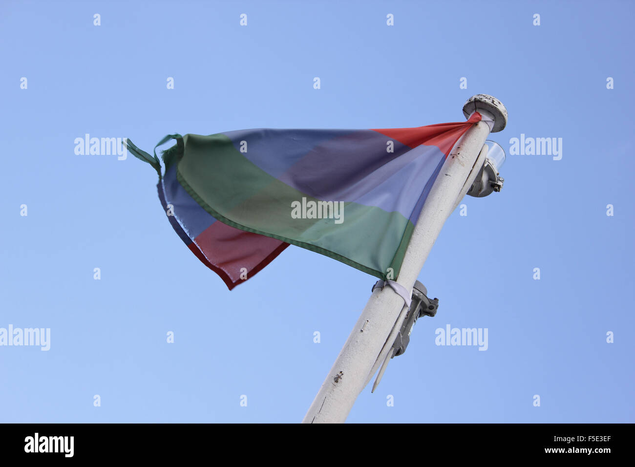 Flag in the wind against the sky - Stock Image
