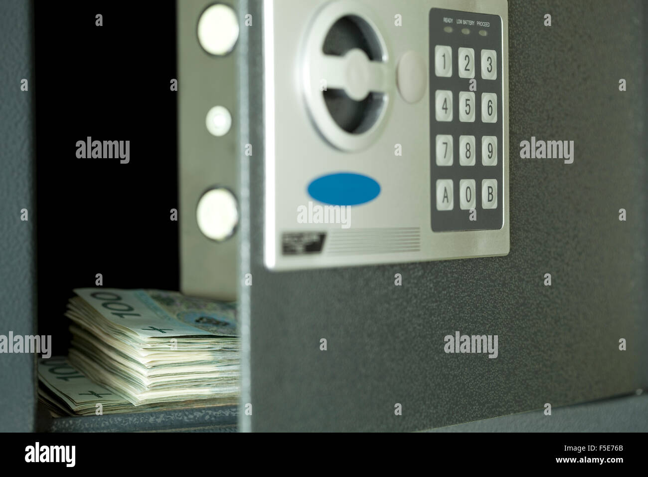 open safe,and in centre hundred Polish money - Stock Image