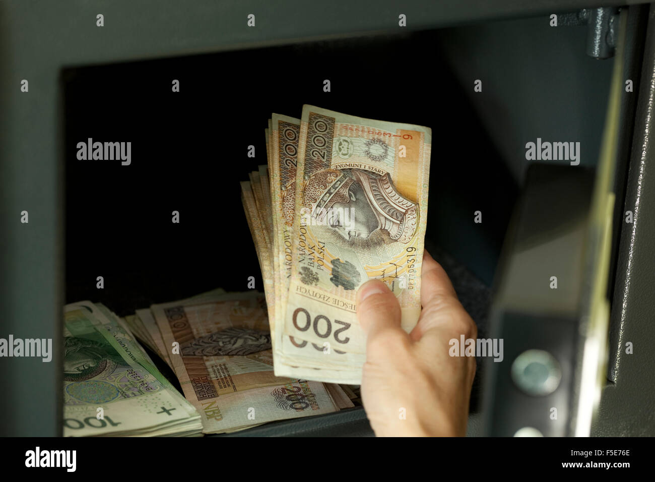 open safe full with Polish notes (hundred and two zloty) - Stock Image