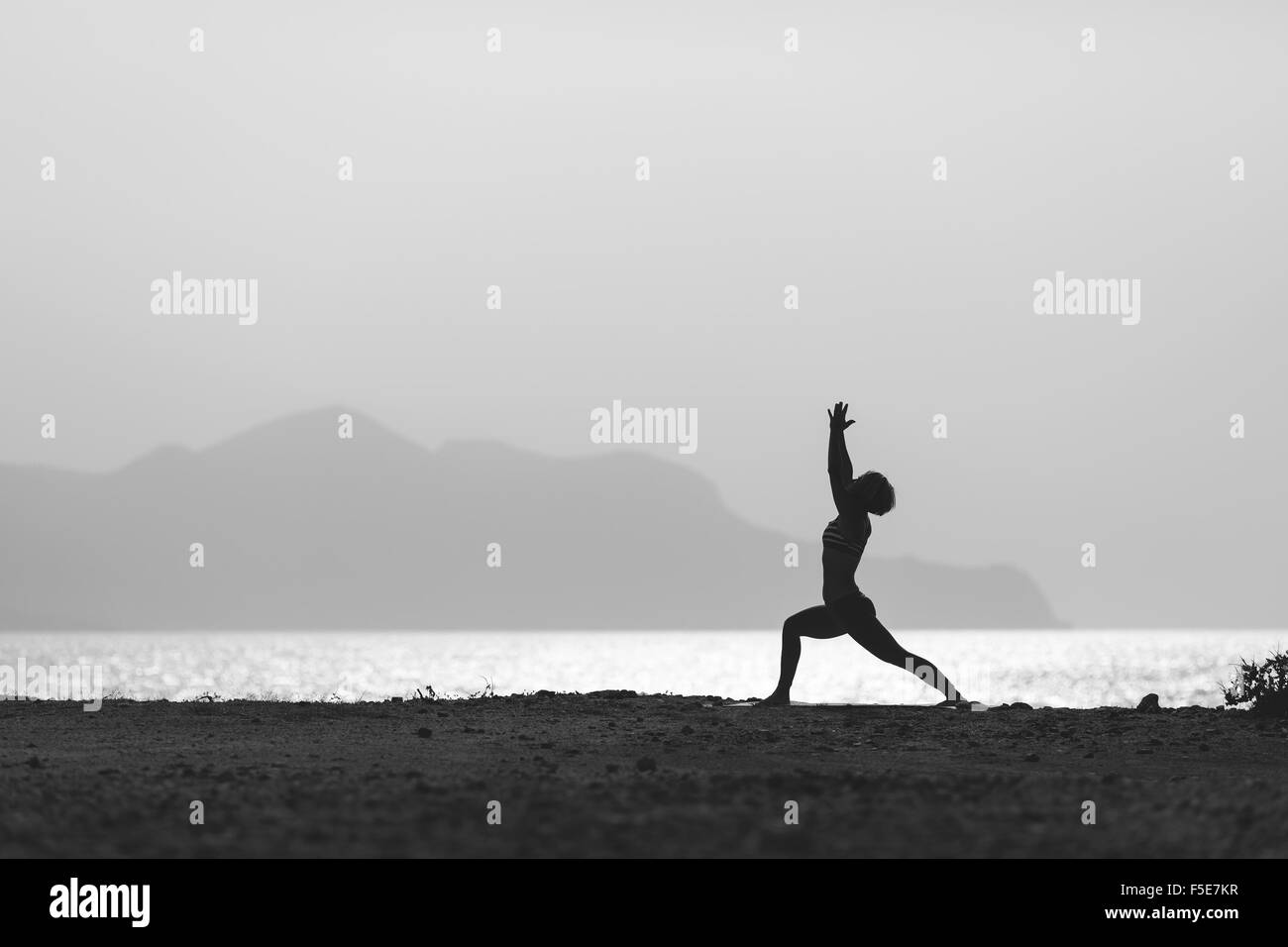 Woman Meditating In Yoga Pose Silhouette At The Ocean Beach And Mountains Motivation Inspirational Exercising Healthy Lif