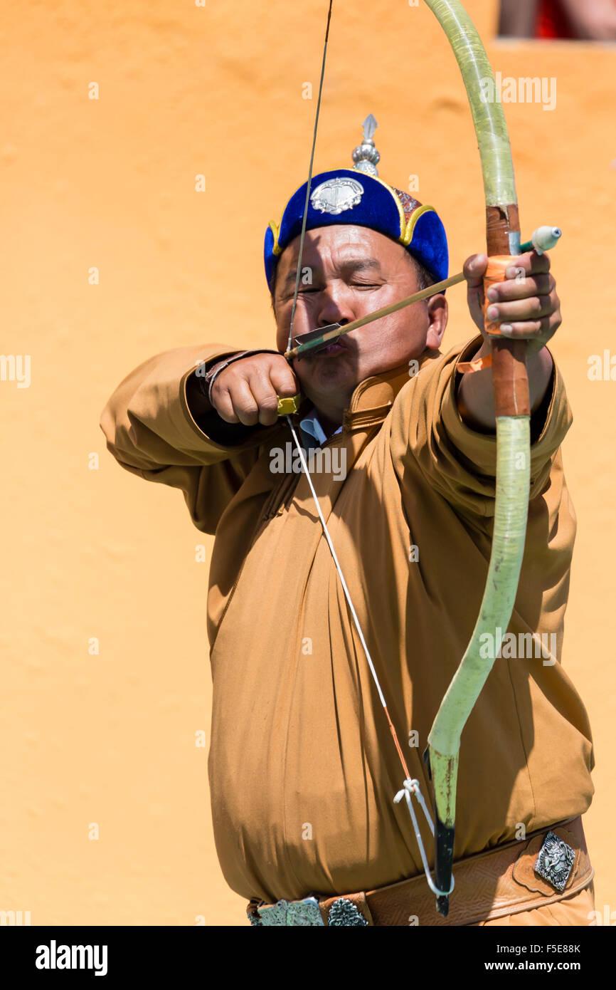 Male archer takes aim, National Archery Tournament, Archery Field, Naadam Festival, Ulaan Baatar (Ulan Bator), Mongolia, - Stock Image