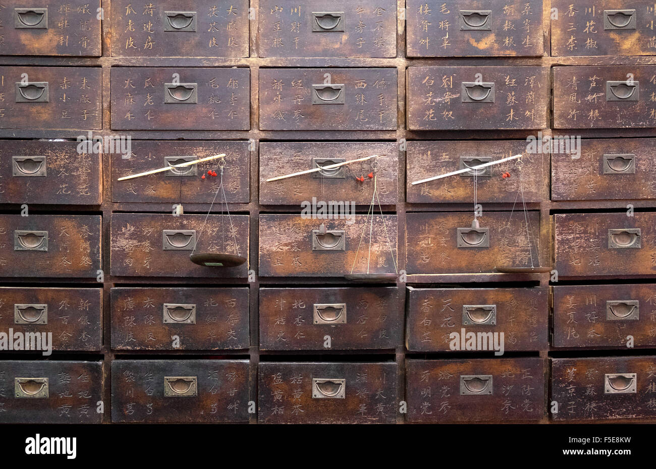 Old wooden drawers and scales in a Chinese pharmacy in  Melaka (Malacca), Malaysia, Southeast Asia, Asia - Stock Image