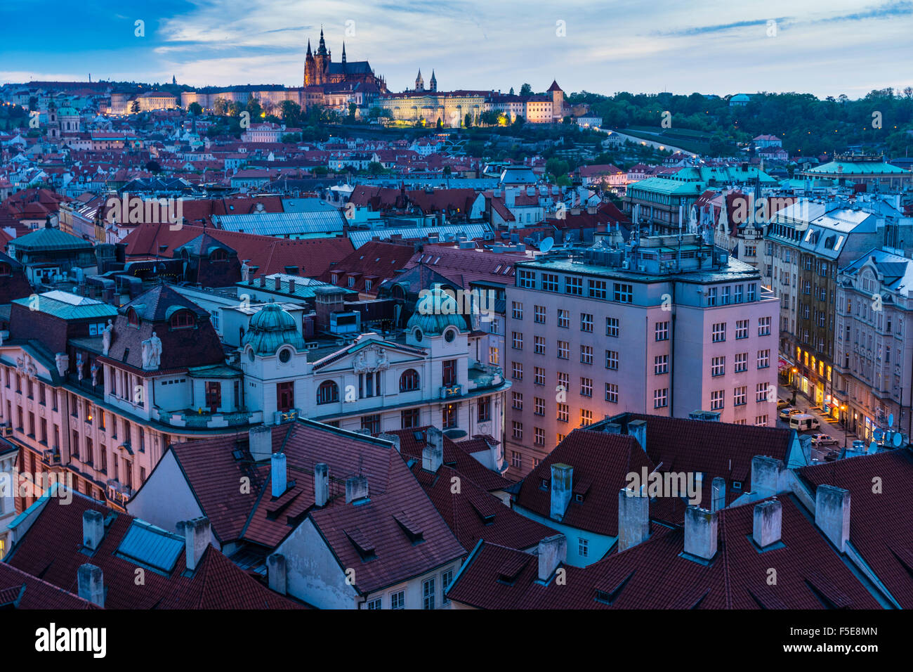 View over the Old Town rooftops towards St. Vitus's Cathedral at dusk, UNESCO World Heritage Site, Prague, Czech Stock Photo