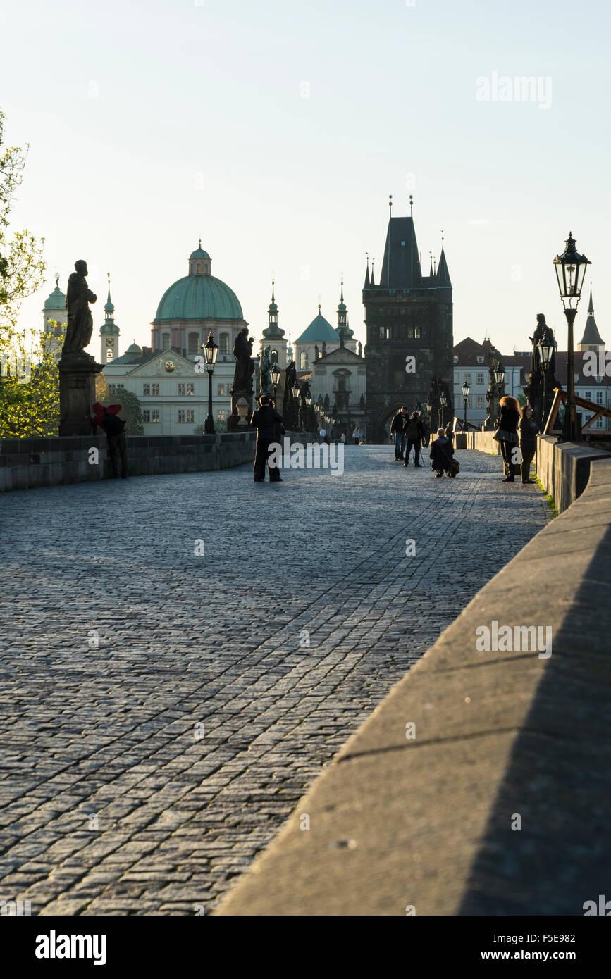 Early morning on Charles Bridge, UNESCO World Heritage Site, Prague, Czech Republic, Europe - Stock Image