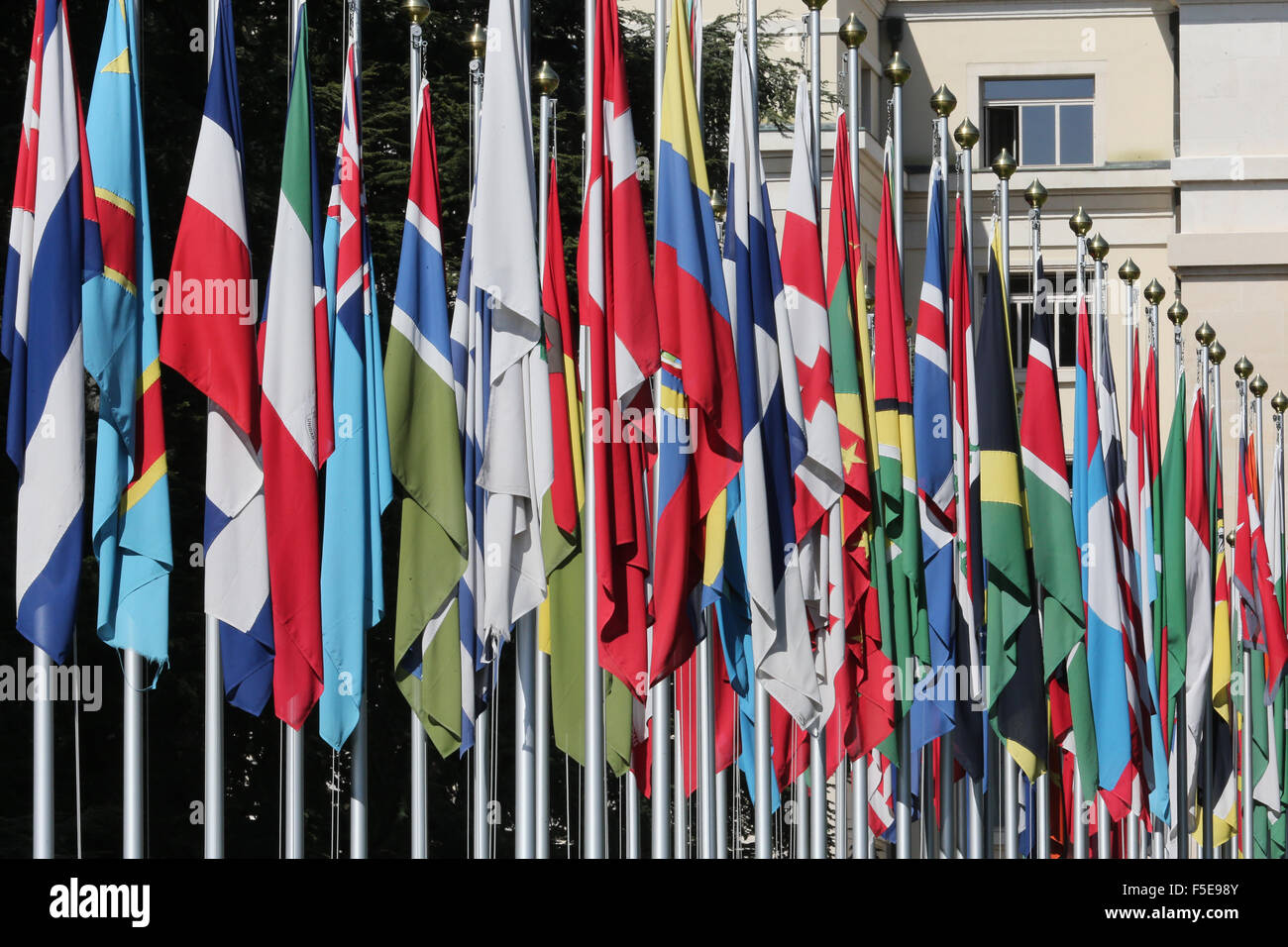 The flag lined approach to the entrance to the United Nations' Headquarters in Geneva, Switzerland, Europe - Stock Image