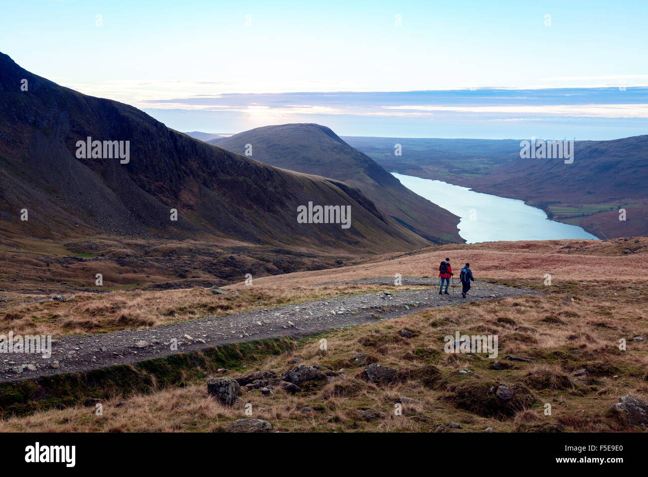Two men descend from Scafell Pike towards Wast Water, Lake District, Cumbria, England, United Kingdom, Europe - Stock Image