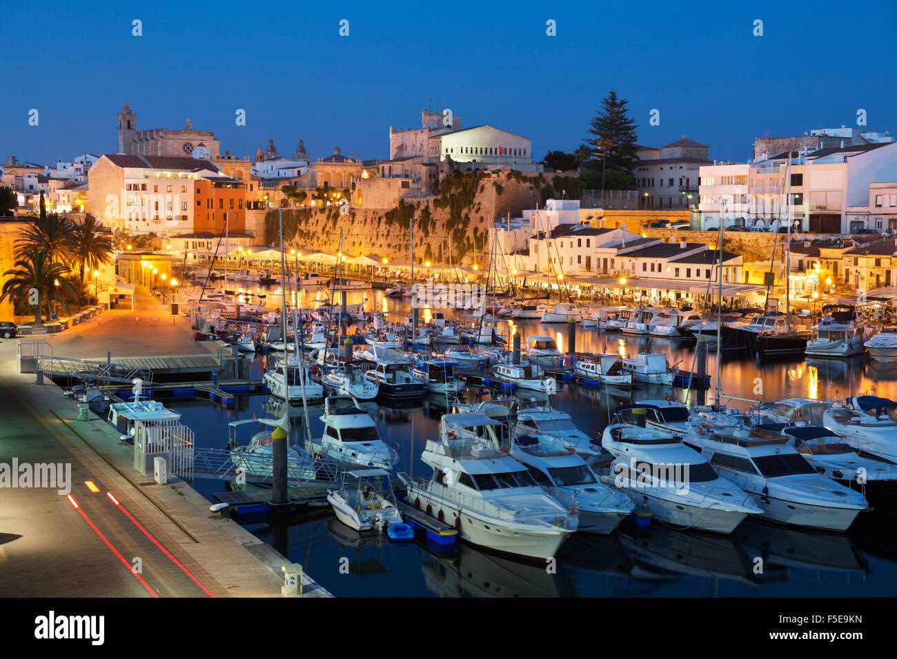 View over harbour and Ayuntamiento de Ciutadella at night, Ciutadella, Menorca, Balearic Islands, Spain, Mediterranean, - Stock Image