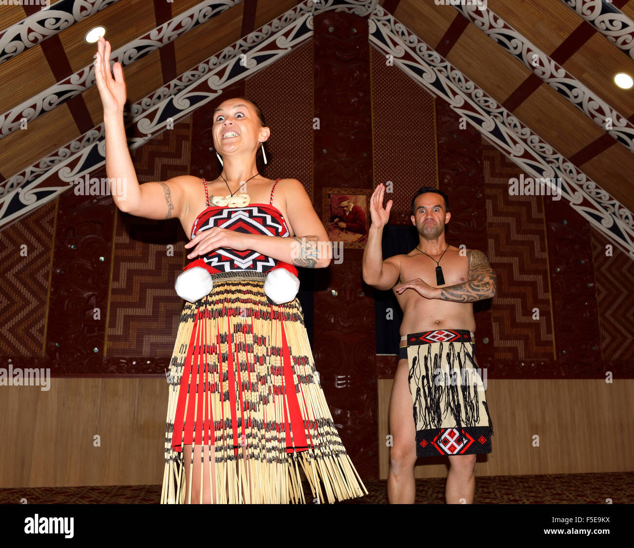 Tourist attraction of Maori song and dancing inside the meeting house (Te aronui a rua )Te Puia Maori Village Rotorua, - Stock Image