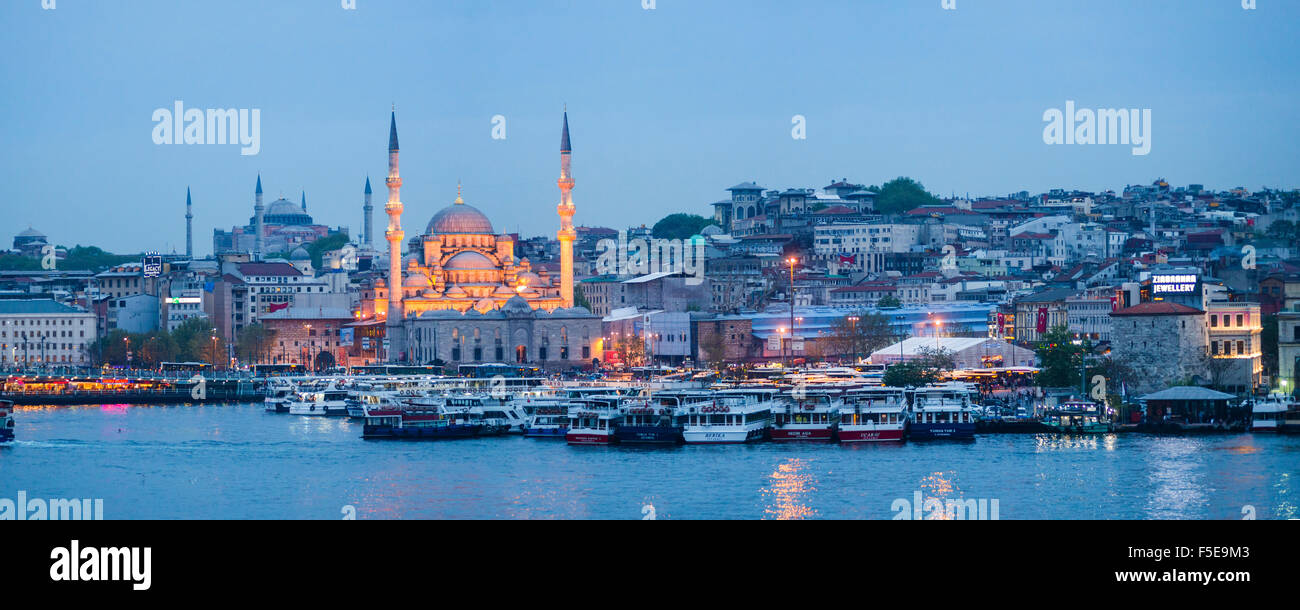 New Mosque (Yeni Cami) on the banks of the Golden Horn at night with Hagia Sophia (Aya Sofya) behind, Istanbul, - Stock Image