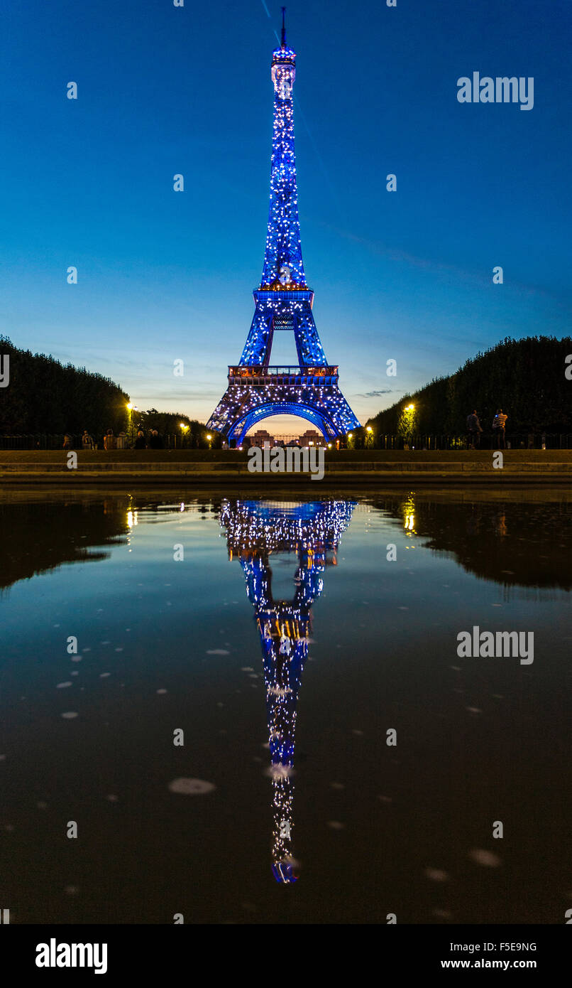Colored lights illuminate the Eiffel Tower, Champ de Mars, Paris, France, Europe Stock Photo
