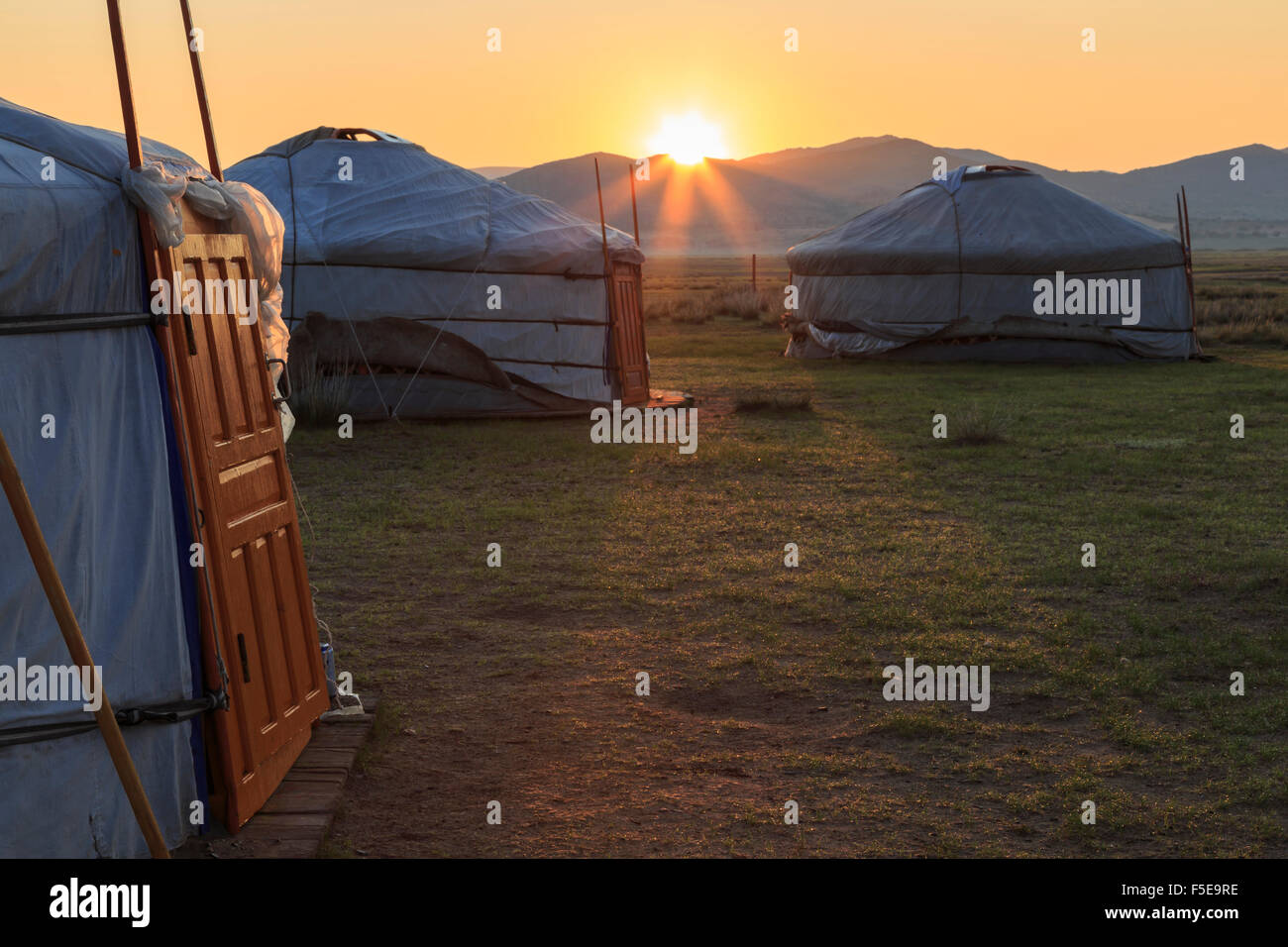 Sunrise over gers in summer, Nomad camp, Gurvanbulag, Bulgan, Northern Mongolia, Central Asia, Asia - Stock Image
