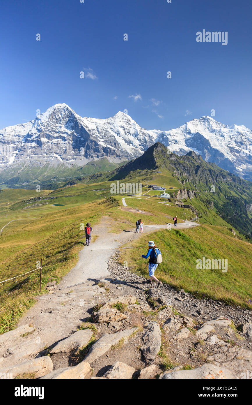 Hikers on the way to Mount Eiger, Mannlichen, Grindelwald, Bernese Oberland, Canton of Bern, Swiss Alps, Switzerland, - Stock Image