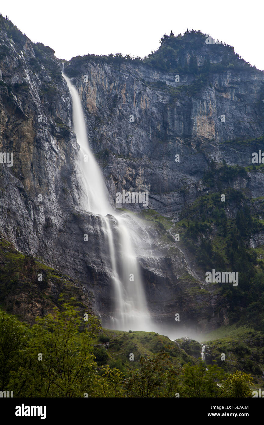 Waterfall in the Natural Park of Lauterbrunnen, Grindelwald, Bernese Oberland, Canton of Bern, Switzerland, Europe - Stock Image