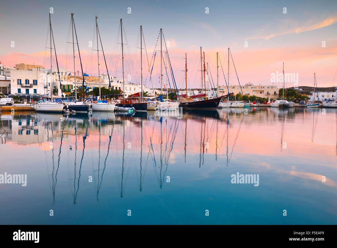 Adamantas harbour and seafront on an early morning - Stock Image