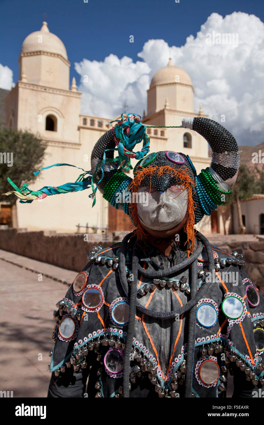 Reveller in costume and mask at Humahuaca carnival in Jujuy province in the Andes region of Argentina, South America - Stock Image