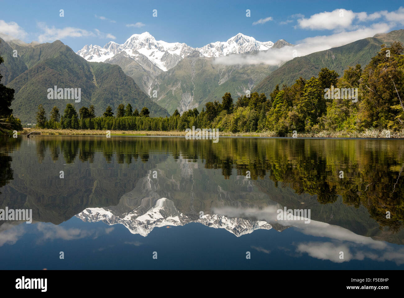 Southern Alps from Lake Matheson, Fox Glacier village, Westland, South Island, New Zealand, Pacific - Stock Image